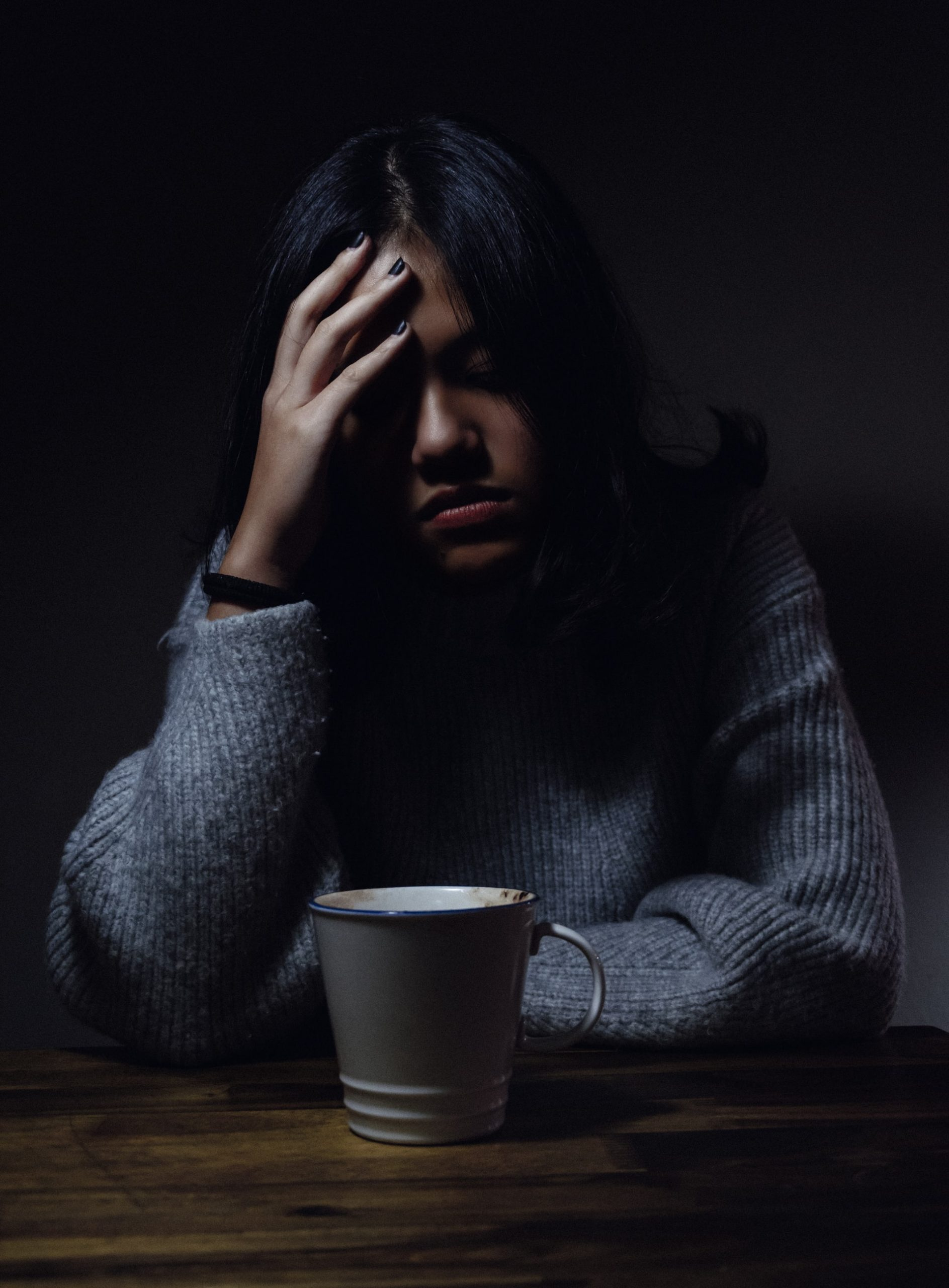 Depressed person with coffee cup