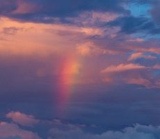 rainbow in pink and purple clouds