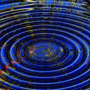 concentric circles rippling on dark blue water