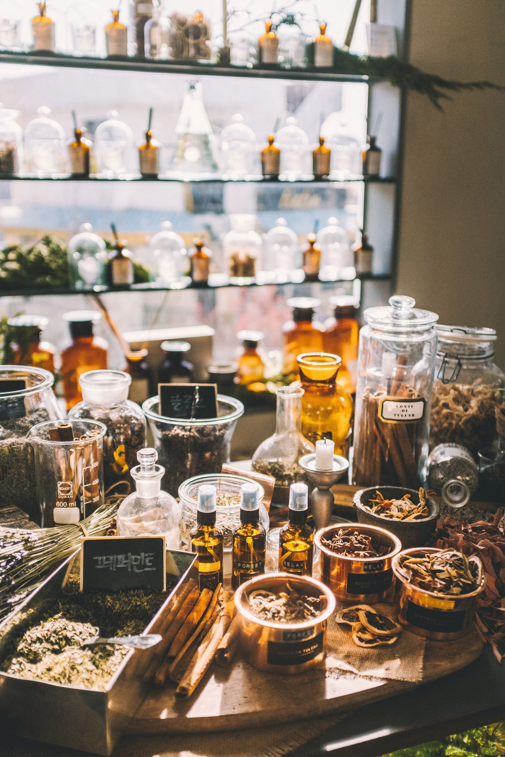 Chinese herbal medicines in jars and bowls